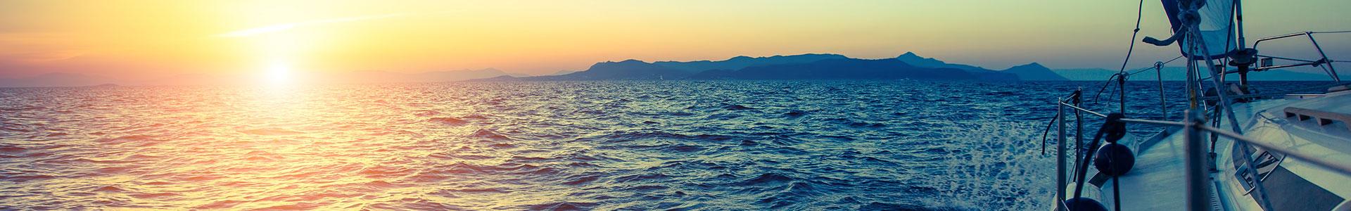boat sailing at dusk